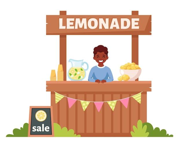 레모네이드 스탠드에서 차가운 레모네이드를 판매하는 아프리카 계 미국인 소년