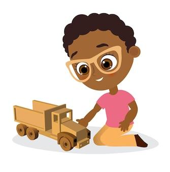 眼鏡とおもちゃの車を持つアフリカ系アメリカ人の少年。車を遊んでいる少年。 。フラットな漫画のスタイル。