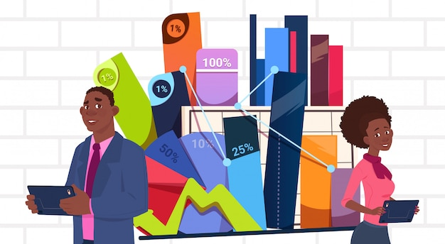 African american businessman and businesswoman holding presentation stand over charts and graph business