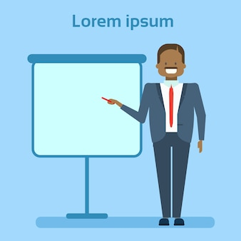 African american businessman pointing to empty white board