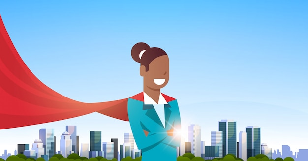 African american businesswoman wearing red super hero cape