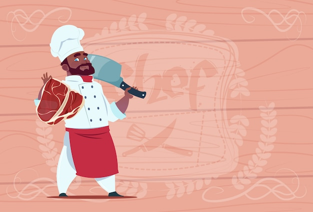 African american chef cook holding cleaver knife and meat smiling cartoon chief in white restaurant uniform over wooden textured background