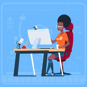 African american girl blogger sit at computer Premium Vector