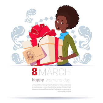African american girl holding gift box with 8 march tag happy women day background creative greeting card design