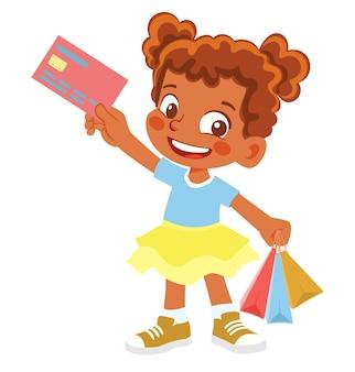 Афро-американская девушка держит кредитную карту. веселая молодая девушка держит сумки