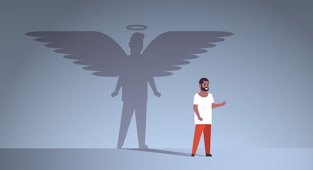 African american guy with shadow of angel