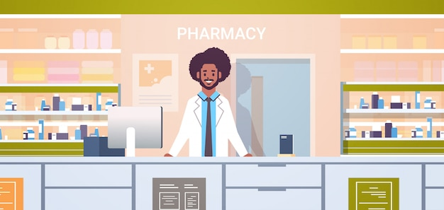 African american male doctor pharmacist standing at pharmacy counter modern drugstore interior medicine healthcare concept horizontal portrait