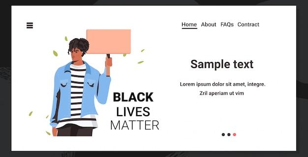 African american man holding blank cardboard banner black lives matter campaign against racial discrimination