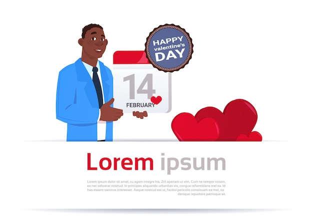 African american man holding calendar page 14 february happy valentines day concept