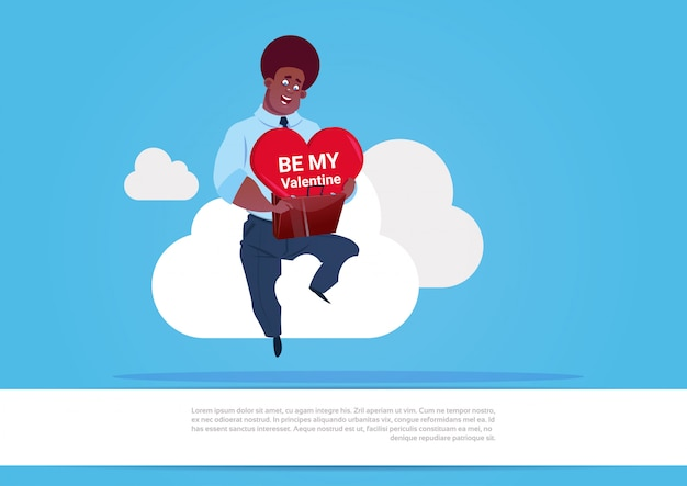 African american man holding heart sit on white cloud over blue background be my valentine love day holiday concept