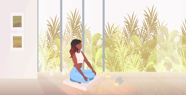 아프리카 계 미국인 여자 앉아 로터스 요가 연습 건강 한 라이프 스타일 개념을 하 고 아름 다운 소녀 포즈