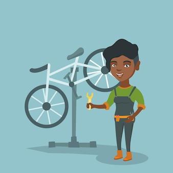 修理店で働くアフリカの自転車整備士。