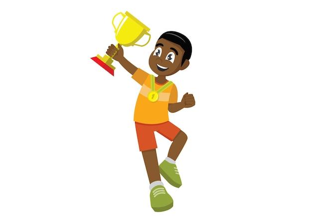 アフリカの少年がジャンプし、彼の手に金色のカップを持って喜ぶ