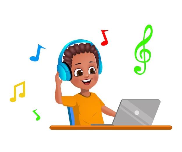 アフリカの男の子の子供はラップトップを介して音楽を聴いています