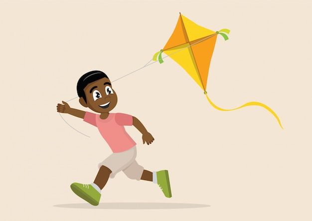African boy playing kite.