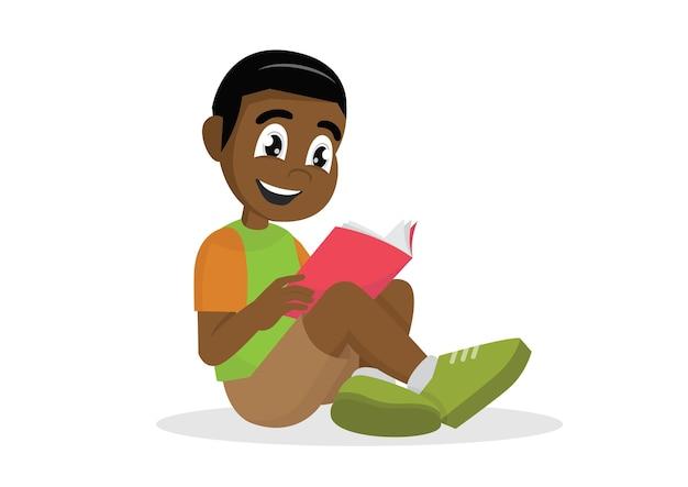 アフリカの少年読書。