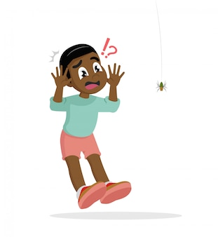 African boy scared of spider.