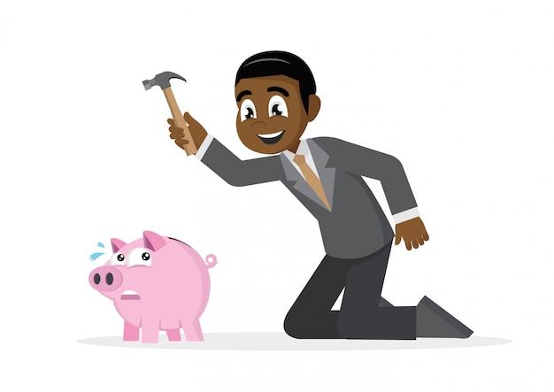 African businessman breaking piggy bank.