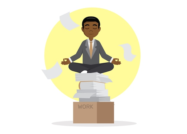 African businessman meditating in peace.