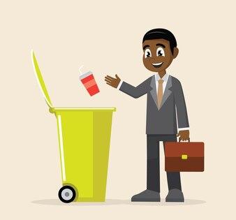 African Businessman throw garbage in trash bin.