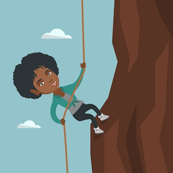 African businesswoman climbing the mountain.