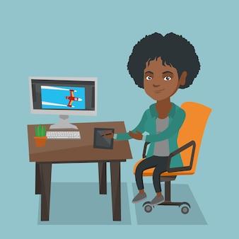 African designer using digital graphics tablet.