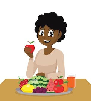 Африканская девушка ест свежие здоровые фрукты