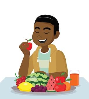 Африканский мужчина ест свежие здоровые фрукты