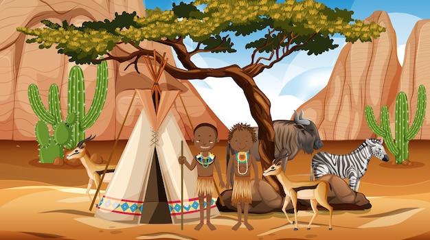 野生の自然の背景にアフリカの部族の家族