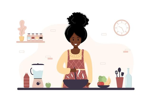 アフリカの女性が台所で料理