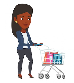 African woman walking with shopping trolley.