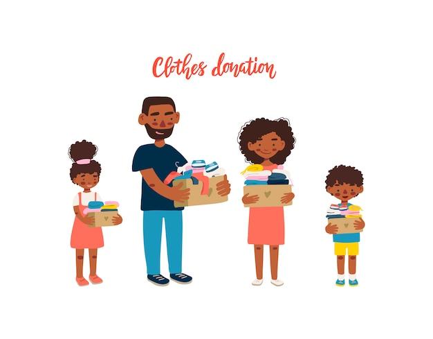 기부금을위한 옷 상자를 들고 아프리카 계 미국 흑인 가족