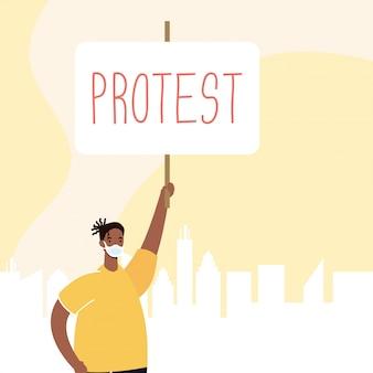 プラカードのイラストで抗議する医療マスクを身に着けているアフロ男