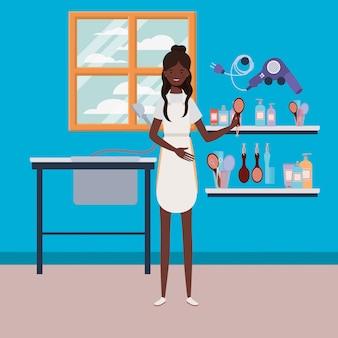 Афро женщина стилист работает в салоне на рабочем месте сцены