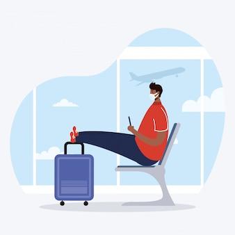 待合室でスーツケースと医療マスクを着ているアフロの若い男