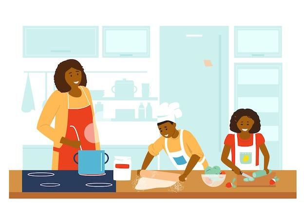 Афроамериканская семья готовит вместе на кухне.