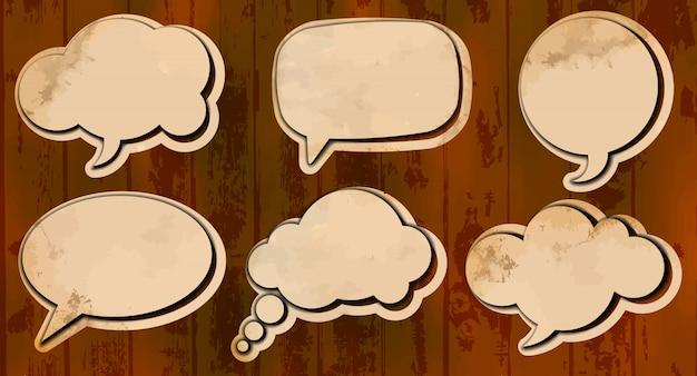 Aged cut out speech bubbles