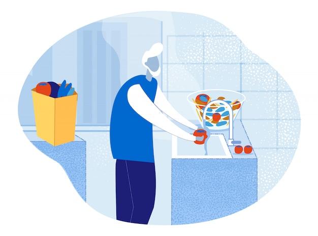 キッチンで野菜を洗う高齢者の年配の男性