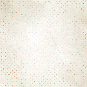Aged and worn paper with polka dots.
