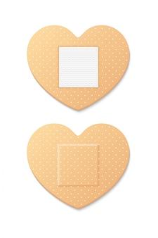 보조 밴드 석고 스트립 의료 패치 하트 양면. 흰색 배경에 그림