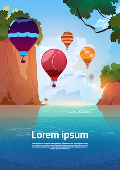 Air balloons flying over summer sea landscape mountain rocks blue water