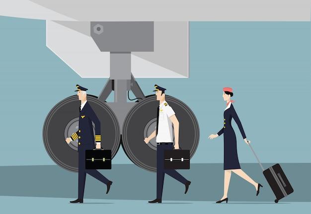 搭乗員。キャプテン、副操縦士、航空機に行くホステス。