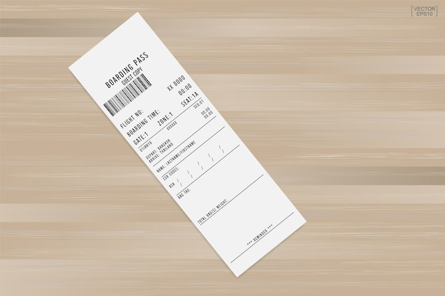 Airline boarding pass ticket on wood.