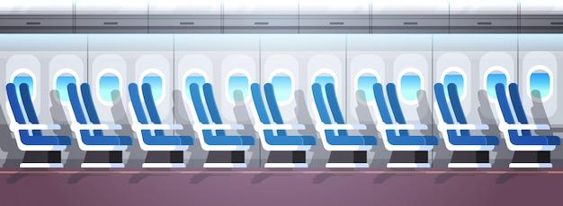 Авиалайнер пассажирские сидения ряд с иллюминаторами пусто нет людей самолет доска интерьер квартира горизонтальный баннер
