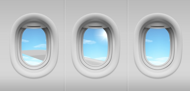 Airplane portholes with sky and wing view