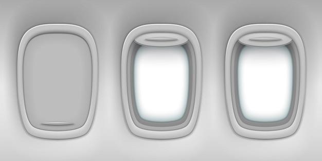 開いたシャッターと閉じたシャッターを備えた飛行機の窓のくぼみは、現実的な航空機の内部を背景にしています