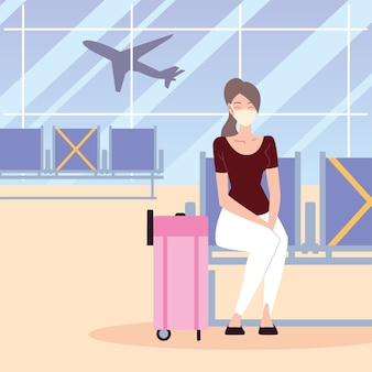 Airport new normal, woman sitting with protective mask and suitcase
