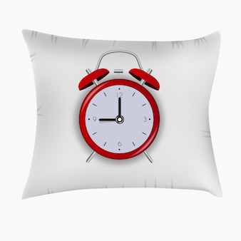 枕の目覚まし時計。おやすみコンセプト。
