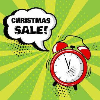 Будильник с белым комическим пузырем с рождественской распродажей. комические звуковые эффекты в стиле поп-арт. векторная иллюстрация.