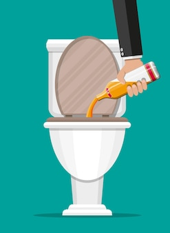 Alcohol abuse concept. hand pours whiskey in toilet. bottle of bourbon. stop alcoholism. rejection..